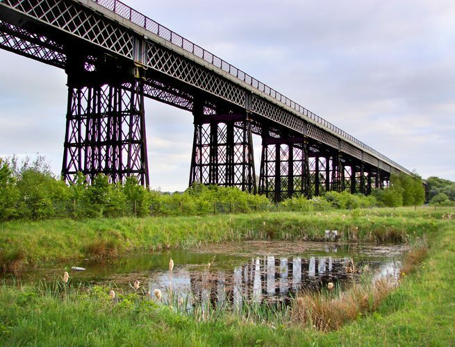 Bennerley Viaduct near Ilkeston, Derbyshire is one of only two surviving wrought iron railway viaducts in the United Kingdom.