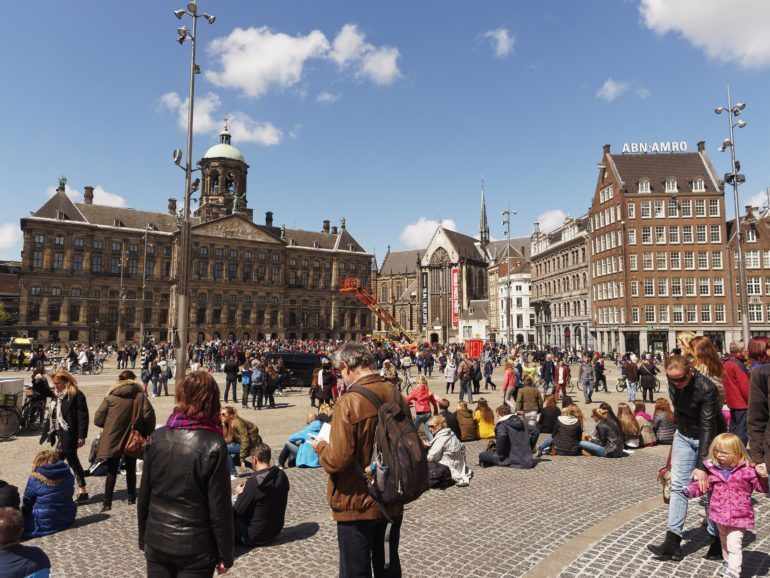 Dam square in Amsterdam is often seen bustling with people.