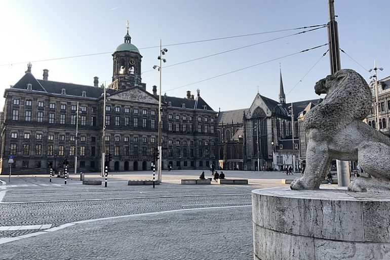 Amsterdam's Dam Square and Royal Palace empty due to lockdown.