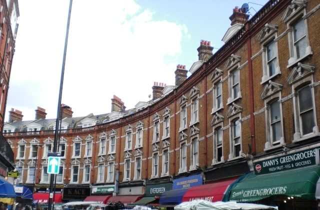 Electric Avenue in Brixton, London, with Victorian houses
