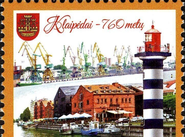a lithuanian stamp featuring the klaipeda lighthouse